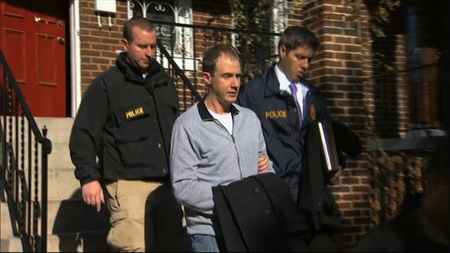 This Dec. 11, 2013, image from video provided by WJLA-TV, shows Ryan Loskarn, former chief of staff to Sen. Lamar Alexander, R-Tenn., being escorted from his Washington home by U.S. Postal Inspector police. Loskarn has been found dead in Maryland, just weeks after the former staffer's arrest on child pornography charges.