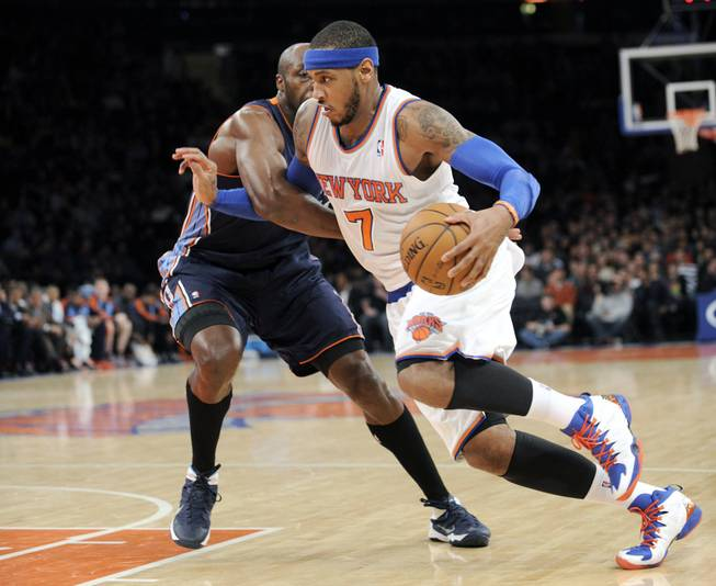 New York Knicks' Carmelo Anthony, right, drives by Charlotte Bobcats' Anthony Tolliver during the second quarter of an NBA basketball game, Friday, Jan. 24, 2014, at Madison Square Garden in New York.
