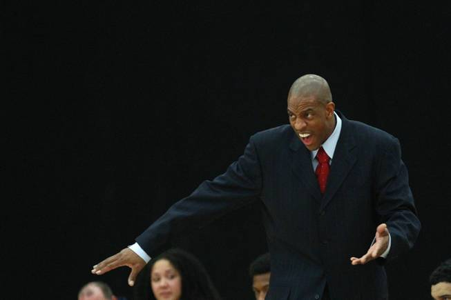Findlay Prep coach Jerome Williams talks to his players during their game against Bishop Gorman Saturday, Jan. 25, 2014 at the South Point. Gorman won 76-72 in overtime.