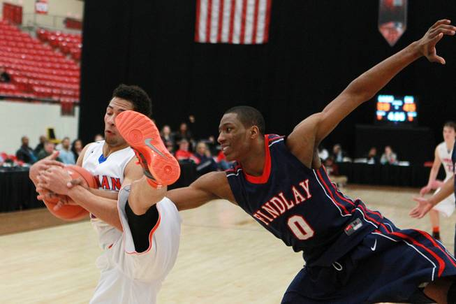 Bishop Gorman guard Noah Robotham is fouled by Findlay Prep forward Horace Spencer during their game Saturday, Jan. 25, 2014 at the South Point. Gorman won 76-72 in overtime.
