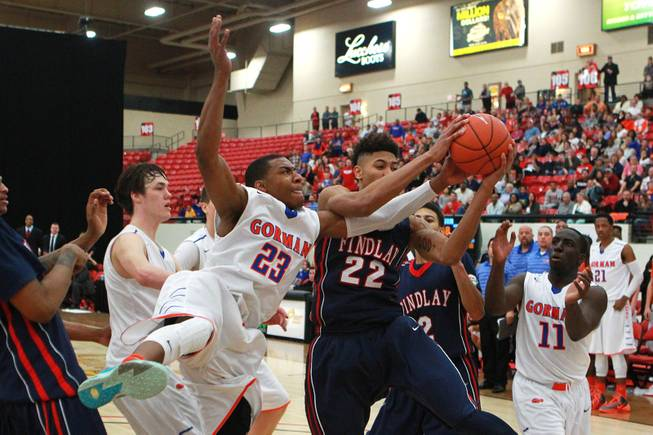 Bishop Gorman forward Nick Blair and Findlay Prep forward Kelly Oubre fight or a rebound during their game Saturday, Jan. 25, 2014 at the South Point. Gorman won 76-72 in overtime.