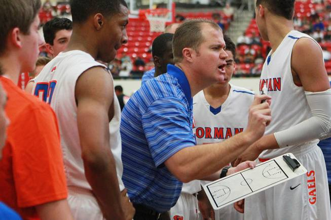 Bishop Gorman coach Grant Rice talks to his players during a time out in their game against  Findlay Prep Saturday, Jan. 25, 2014 at the South Point. Gorman won 76-72 in overtime.