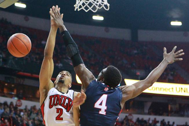 UNLV forward Khem Birch is fouled by Fresno St. forward Karachi Edo during their game Saturday, Jan. 25, 2014 at the Thomas & Mack Center.