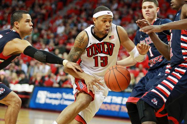 UNLV guard Bryce Dejean Jones is fouled by Fresno St. guard Cezar Guerrero during their game Saturday, Jan. 25, 2014 at the Thomas & Mack Center. UNLV won 75-73 in overtime.