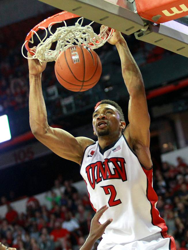 UNLV forward Khem Birch dunks on Fresno St. during their game Saturday, Jan. 25, 2014 at the Thomas & Mack Center. UNLV won 75-73 in overtime.