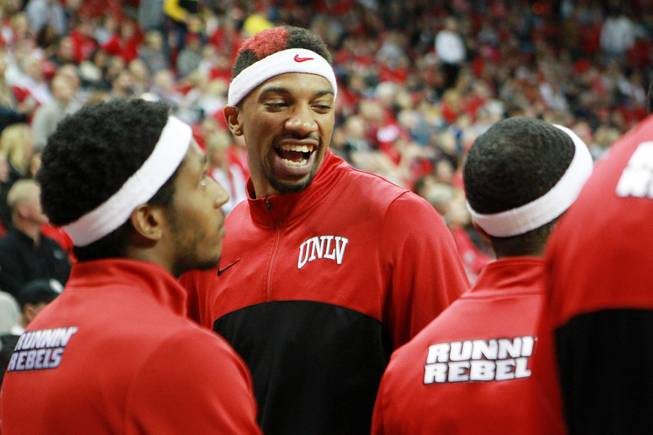UNLV forward Khem Birch jokes with his teammates before their game against Fresno St. Saturday, Jan. 25, 2014 at the Thomas & Mack Center. UNLV won 75-73 in overtime.
