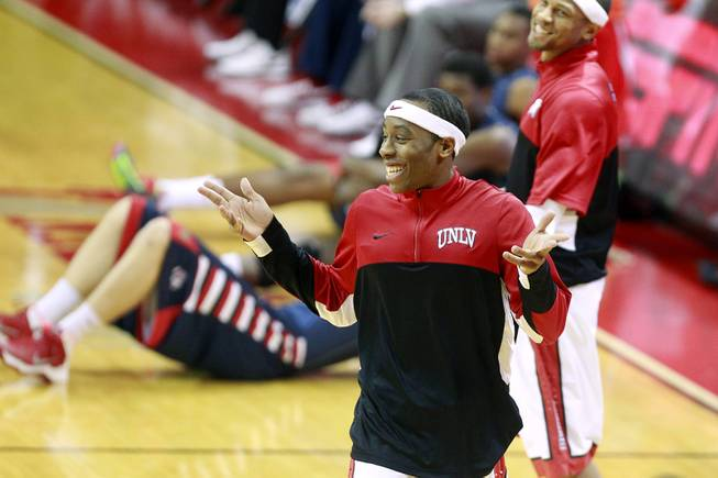 UNLV guard Kevin Olekaibe smiles while warming up for their game against his former team, Fresno St., Saturday, Jan. 25, 2014 at the Thomas & Mack Center.