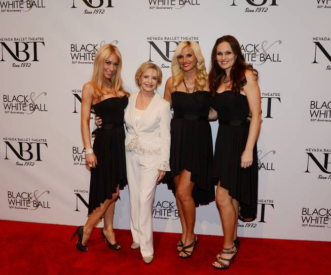 Florence Henderson, second from left, and Bella Electric Strings arrive at Nevada Ballet Theater's 30th anniversary Black & White Ball honoring Henderson on Saturday, Jan. 25, 2014, in Aria.