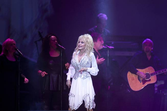 "Dolly Parton performs during her ""Blue Smoke World Tour"" stop at Star of the Desert Arena in Buffalo Bill's on Saturday, Jan. 25, 2014, in Primm."