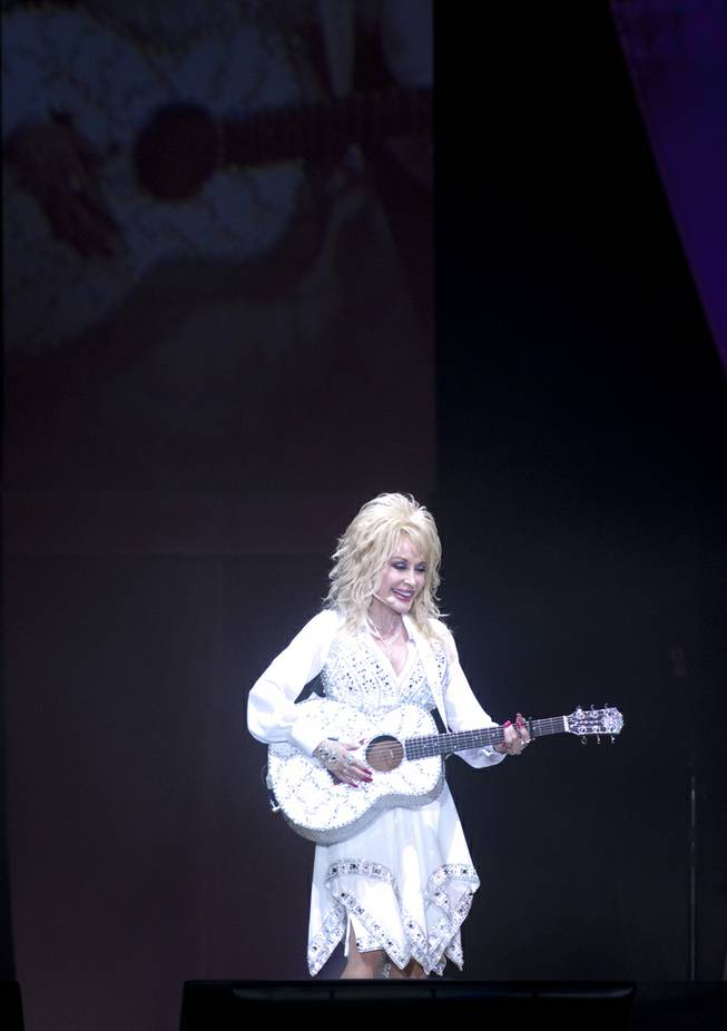 "Dolly Parton performs ""Jolene"" during her ""Blue Smoke World Tour"" stop at Star of the Desert Arena in Buffalo Bill's on Saturday, Jan. 25, 2014, in Primm."