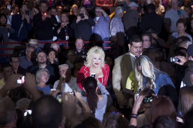 "A Dolly Parton lookalike excites fans before Parton began her ""Blue Smoke World Tour"" stop at Star of the Desert Arena in Buffalo Bill's on Saturday, Jan. 25, 2014, in Primm."