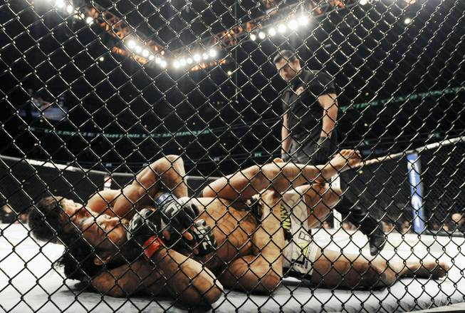 Josh Thomson, back, wrestles Benson Henderson during the main event of the UFC mixed martial arts match in Chicago, Saturday, Jan., 25, 2014.