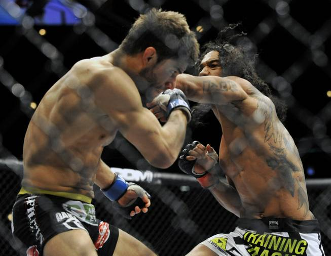 Benson Henderson right, punches Josh Thomson during the main event of the UFC mixed martial arts event in Chicago, Saturday, Jan., 25, 2014.