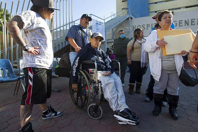 Francisco Diaz of Las Vegas is met by family members outside the general hospital after a doctor's appointment in Mexicali, Mexico Sunday, Jan. 26, 2014. Diaz was born in Mexico but grew up in Las Vegas with a green card. Diaz was beaten and robbed after he was deported to Mexicali.