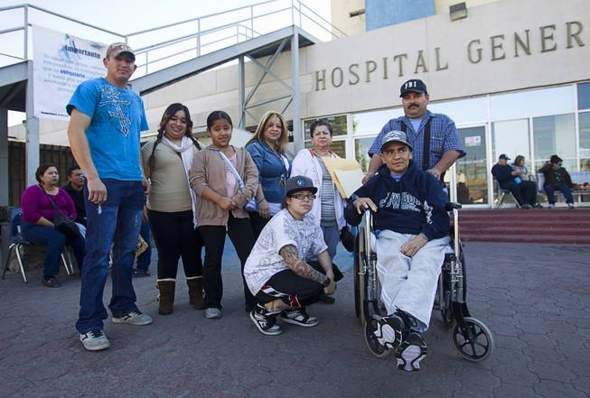 Francisco Diaz of Las Vegas poses with family members and assistant Jose Alberto Ramirez outside the general hospital after a doctor's appointment in Mexicali, Mexico Sunday, Jan. 26, 2014. Diaz was born in Mexico but grew up in Las Vegas with a green card. Diaz was beaten and robbed after he was deported to Mexicali.