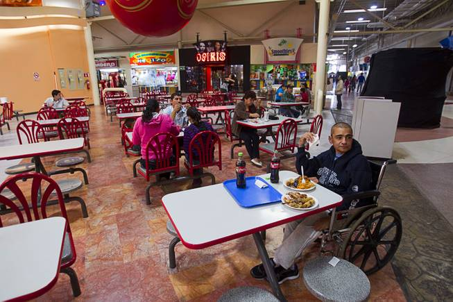 Francisco Diaz has lunch in a shopping mall in Mexicali, Mexico Sunday, Jan. 26, 2014. Diaz was born in Mexico but grew up in Las Vegas with a green card. Diaz was beaten and robbed after he was deported to Mexicali.