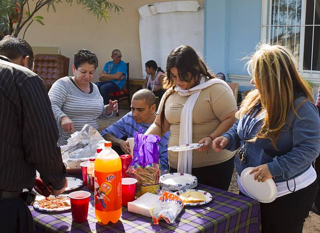 Francisco Diaz eats lunch with family at an elderly care home in Mexicali, Mexico Sunday, Jan. 26, 2014. Diaz is staying at the home while he is recovering from an robbery and assault that put him in a coma for three weeks. Diaz was born in Mexico but grew up in Las Vegas with a green card.