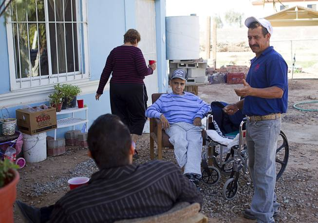 Francisco Diaz, center, at an elderly care home in Mexicali, Mexico Sunday, Jan. 26, 2014. Diaz is staying at the home while he is recovering from an robbery and assault that put him in a coma for three weeks. Diaz was born in Mexico but grew up in Las Vegas with a green card.