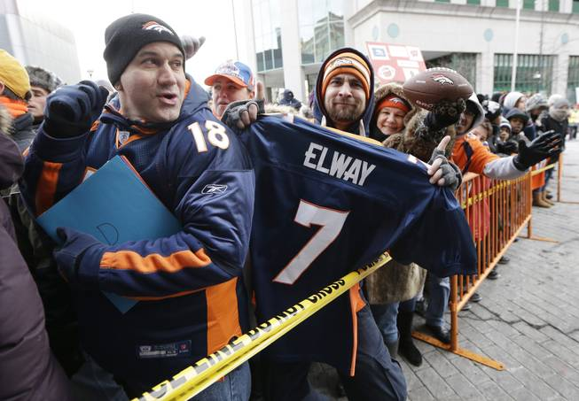 Denver Broncos fans wait for players to arrive at the team hotel Sunday, Jan. 26, 2014, in Jersey City, N.J. The Broncos are scheduled to play the Seattle Seahawks in the NFL Super Bowl XLVIII football game Sunday, Feb. 2, in East Rutherford, N.J.