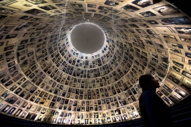 A visitor walks at the Hall of Names at the Yad Vashem Holocaust memorial in Jerusalem, ahead of the International Holocaust Remembrance Day, Sunday, Jan. 26, 2014.