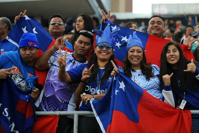 Samoan Rugby fans pose for a photo on the final day of the USA 7's rugby tournament at Sam Boyd Stadium on Sunday afternoon.