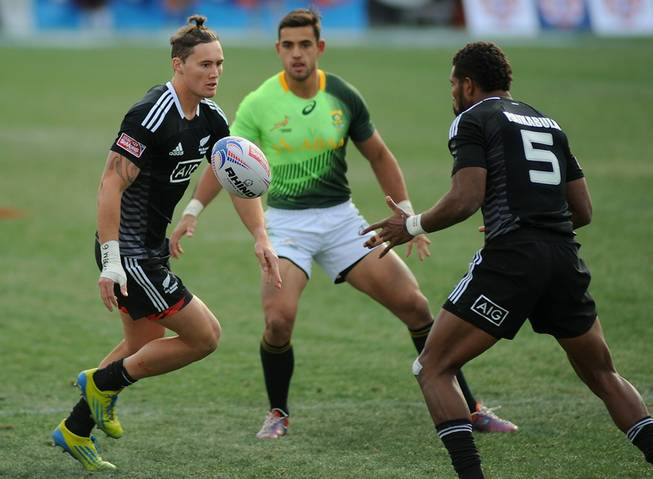 All Blacks 7s player Gillies Kaka, left, passes the ball to New Zealand teammate Lote Raikabula (5) during the Cup Final match of the Las Vegas 7's Rugby tournament at Sam Boyd Stadium on Sunday afternoon.