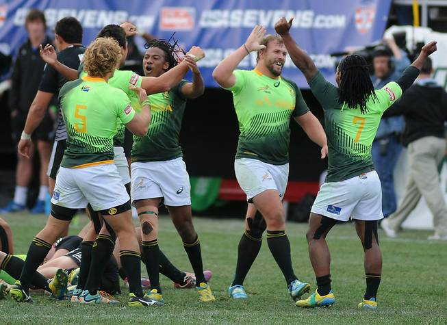 South African players celebrate after defeating New Zealand 14-7 in the Cup Final match of the USA Sevens Rugby tournament Sunday, Jan. 26, 2014, at Sam Boyd Stadium.
