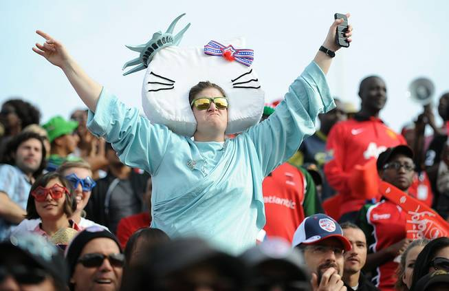 A costumed rugby fan dances in the crowd during the final day of the USA 7's rugby tournament at Sam Boyd Stadium on Sunday afternoon.