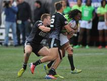 South African player Cecil Afrika gets hit by New Zealand players Tim Mikkelson and Ambrose Curtis during the Cup Final match of the USA 7's ...