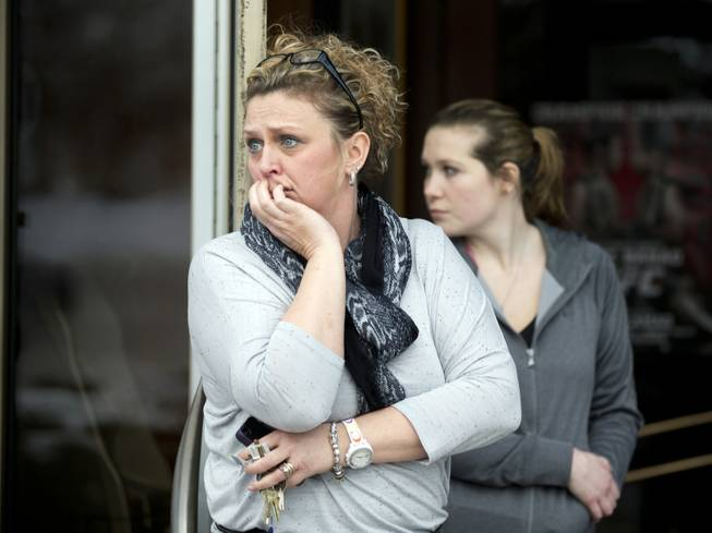 Restaurant general manager Heather Saffield and employee Chelsea Borschart, right, look outside their restaurant at the Mall in Columbia on Saturday, Jan. 25, 2014, in Columbia, Md.