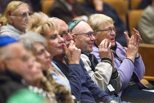 Members of the congregation applaud Ret. Major Leonard Berney at Congregation Ner Tamid in Henderson Monday, Jan. 27, 2014. Berney was a member of British forces that liberated the Bergen-Belsen concentration camp during Word War II. The presentation was part of International Holocaust Memorial Day.
