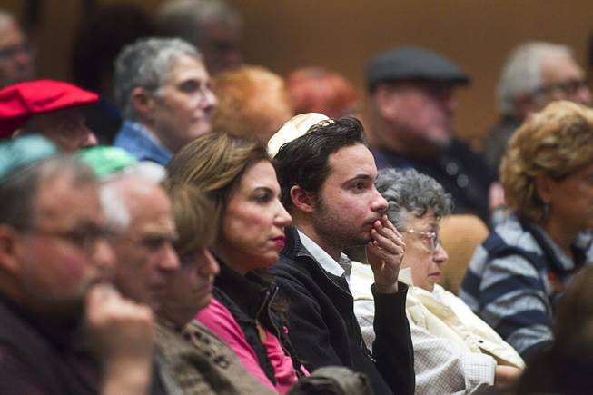 People listen to Ret. Major Leonard Berney at Congregation Ner Tamid in Henderson Monday, Jan. 27, 2014. Berney was a member of British forces that liberated the Bergen-Belsen concentration camp during Word War II. The presentation was part of International Holocaust Memorial Day.