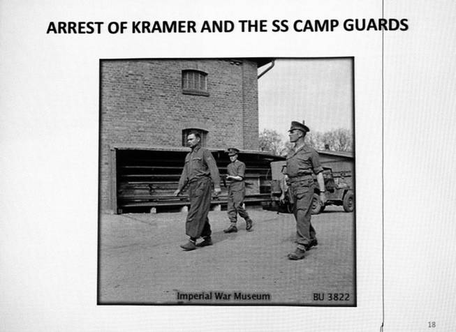 A photo shows the arrest of Josef Kramer, commandant of Bergen-Belsen concentration camp, during a presentation by Ret. Major Leonard Berney at Congregation Ner Tamid in Henderson Monday, Jan. 27, 2014. Berney was a member of British forces that liberated the concentration camp during Word War II. The presentation was part of International Holocaust Memorial Day.