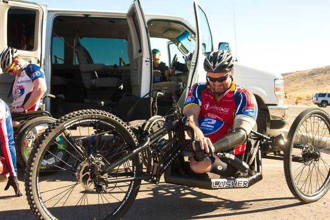 John Masson, a U.S. Army Special Forces Veteran, prepares his 3-wheel hand-powered mountain bike, built by Bill Lasher of Las Vegas, for the Ride 2 Recovery Las Vegas Mountain Bike Challenge at Blue Diamond Monday, Jan. 27, 2014. Masson, who lost 3 limbs during a roadside bomb attack in Afghanistan in Oct. of 2010, is among many wounded veterans who are being helped by Ride 2 Recovery, a nonprofit organization that provides rehabilitation to injured veterans through cycling.
