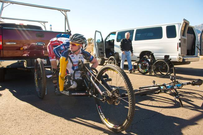 29 year-old Staff Sergeant Tim Brown, a USMC Explosive Ordnance Disposal Specialist, prepares his 3-wheel hand-powered mountain bike, built by Bill Lasher of Las Vegas, for the Ride 2 Recovery Las Vegas Mountain Bike Challenge at Blue Diamond Monday, Jan. 27, 2014. Brown, who lost 3 limbs during a roadside bomb attack in Afghanistan in Oct. of 2011, is among many wounded veterans who are being helped by Ride 2 Recovery, a nonprofit organization that provides rehabilitation to injured veterans through cycling.