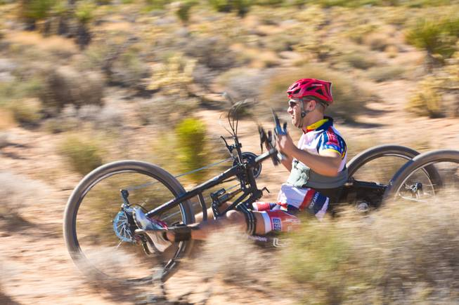 26 year-old Nathan DeWalt, Navy Veteran, navigates through Blue Diamond on a 3-wheel hand-powered mountain bike, built by Bill Lasher of Las Vegas, during the Ride 2 Recovery Las Vegas Mountain Bike Challenge Monday, Jan. 27, 2014. DeWalt, who was paralyzed from the waist down after motorcycle crash in 2008, is among many wounded veterans who are being helped by Ride 2 Recovery, a nonprofit organization that provides rehabilitation to injured veterans through cycling.