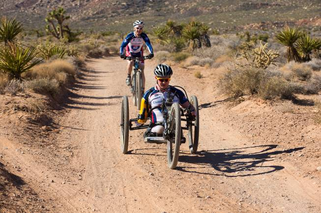 29 year-old Staff Sergeant Tim Brown, a USMC Explosive Ordnance Disposal Specialist, navigates through Blue Diamond on a 3-wheel hand-powered mountain bike, built by Bill Lasher of Las Vegas, during the Ride 2 Recovery Las Vegas Mountain Bike Challenge Monday, Jan. 27, 2014. Brown, who lost 3 limbs during a roadside bomb attack in Afghanistan in Oct. of 2011, is among many wounded veterans who are being helped by Ride 2 Recovery, a nonprofit organization that provides rehabilitation to injured veterans through cycling.