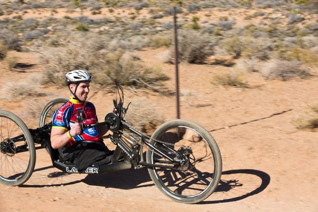 27 year-old USMC Infantryman Kevin Dubois navigates through Blue Diamond on a 3-wheel hand-powered mountain bike, built by Bill Lasher of Las Vegas, during the Ride 2 Recovery Las Vegas Mountain Bike Challenge Monday, Jan. 27, 2014. Dubois, who lost both legs during a roadside bomb attack in Afghanistan in Oct. of 2011, is among many wounded veterans who are being helped by Ride 2 Recovery, a nonprofit organization that provides rehabilitation to injured veterans through cycling.