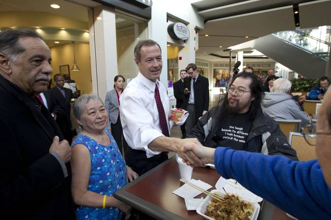 Maryland Gov. Martin O'Malley shakes hands with customers at the Mall in Columbia, Md, after the mall was reopened to the public on Monday, Jan. 27, 2014.