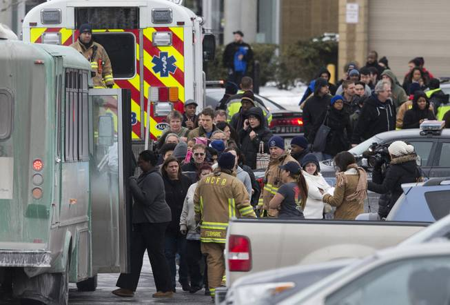 Mall shoppers are loaded onto shuttle busses and evacuated by police and rescue personnel after a shooting at The Mall in Columbia on Saturday, Jan. 25, 2014, in Columbia, Md. Police say three people died in a shooting at the mall in suburban Baltimore, including the presumed gunman.