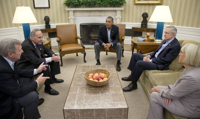 In this Oct. 12, 2013, file photo, from left, Sen. Dick Durbin, D-Ill., Sen. Charles Schumer, D-N.Y., President Barack Obama, Senate Majority Leader Harry Reid of Nevada, Sen. Patty Murray, D-Wash., meet in the Oval Office of the White House in Washington. When Obama delivers his State of the Union address on Jan. 28, 2014, he isn't just setting out his own agenda. He's also delivering an opening salvo in the yearlong fight for control of Congress.