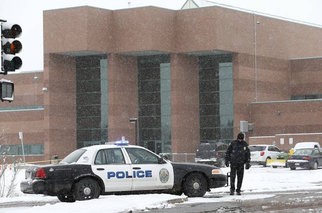 A police cruiser blocks the entrance to Standley Lake HIgh School, where classes were cancelled after an apparent suicide attempt by a student, in Westminster, Colo., Monday, Jan. 27, 2014. Police say a 16-year-old boy was critically injured after setting himself on fire at the suburban Denver high school.
