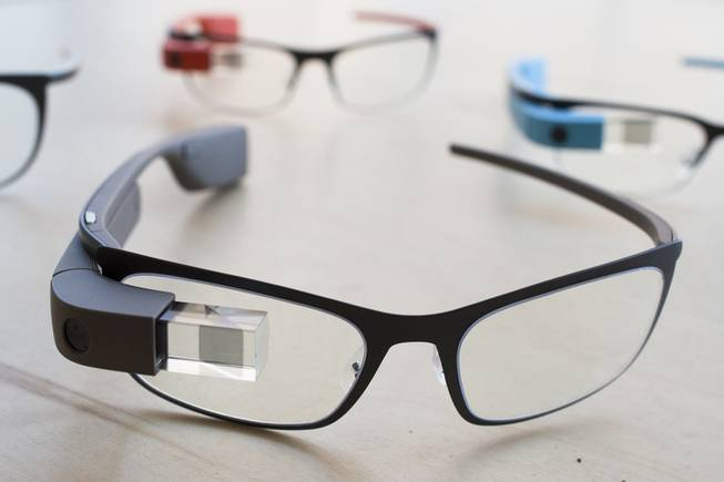 "The new Google Glass ""Bold"" prescription frames in the color ""shale"" rest on a table at Google Glass Basecamp space at Chelsea Market, Friday, Jan. 24, 2014, in New York."