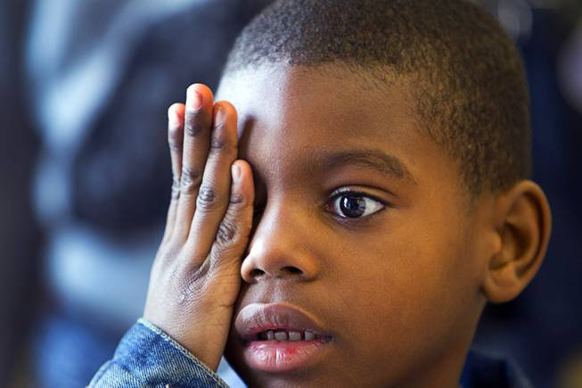 Kah'Maurri Steward, 6, a kindergarten student at Hoggard Elementary School, covers an eye during a preliminary vision test at the Andre Agassi College Preparatory Academy Tuesday, Jan. 27, 2014. Over 100 Clark County School District students received free eye exams and new glasses from OneSight. OneSight is an organization providing access to eye care and eyewear to underserved communities.