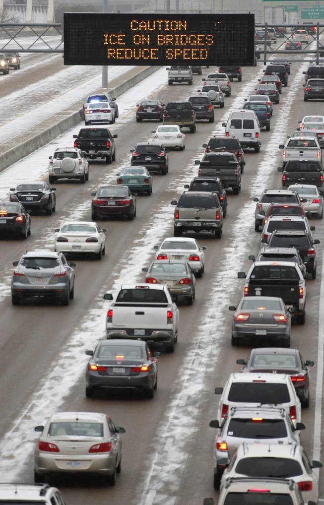 Traffic creeps along Interstate 55 in north Jackson, Miss., Tuesday, Jan. 28, 2014, as ice and snow flurries cause difficult driving conditions. A severe winter storm is expected to hit the state bringing ice and snow to the Gulf Coast.