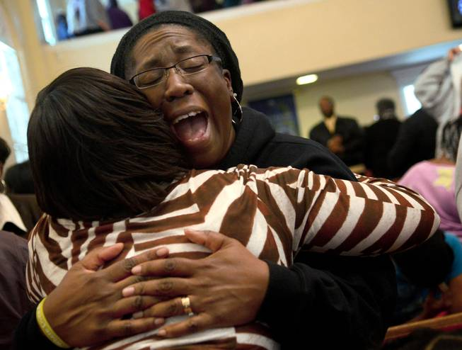 Charita Grant, left, holds Karey Pierre, right, while she cries out in prayer on Tuesday, Jan. 28, 2014, after the Concert of Prayer at Word Tabernacle Church in Rocky Mount, N.C. Pierre, a teacher at SouthWest Edgecombe High School, was at the church when four youths were shot Monday behind the building on the basketball court.