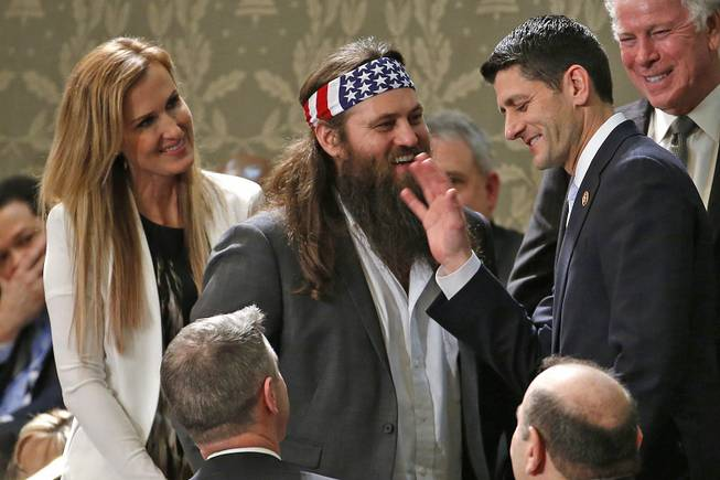 """Duck Dynasty's"" Willie Robertson, center, and his wife Korie talk with Rep. Paul Ryan, R-Wis., before President Barack Obama's State of the Union address Tuesday, Jan. 28, 2014, on Capitol Hill in Washington, D.C."