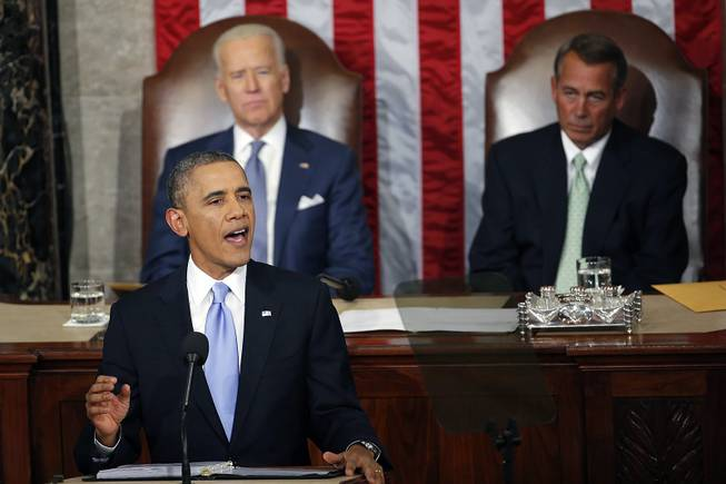 President Barack Obama gives his State of the Union address on Capitol Hill in Washington, Tuesday Jan. 28, 2014, as Vice President Joe Biden and House Speaker John Boehner of Ohio, listen.
