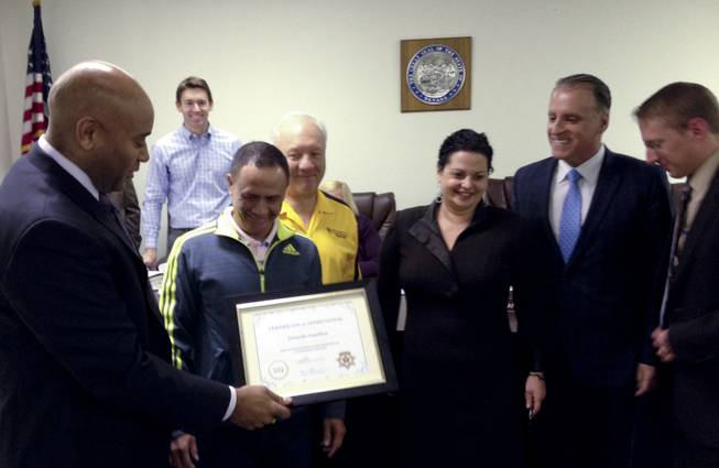 Taxicab Authority Administrator Charles Harvey presents a certificate to Yellow Checker Star cab driver Gerardo Gamboa, who discovered $300,000 in a bag in his cab and returned it to its owner last month. YCS manager Bill Shranko and authority board members Joshua Miller, rear, and Chairman Ileana Drobkin, Dean Collins and Joseph Hardy Jr. were also on hand for the presentation Jan. 28, 2014.