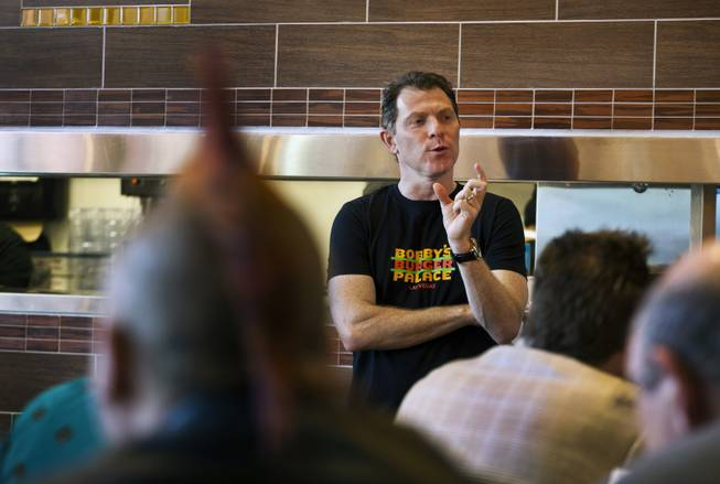 Chef Bobby Flay talks after the ribbon-cutting ceremony of his Bobby's Burger Palace on Wednesday, Jan. 29, 2014, on the Strip in Las Vegas.